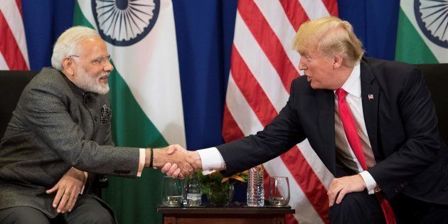 US President Donald Trump shakes hands with Indian Prime Minister Narendra Modi during a bilateral meeting...