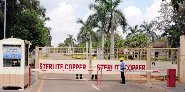 A private security guard stands in front of the main gate of Sterlite Industries Ltd's copper plant in