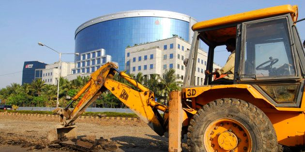 Road construction takes place near the IL&FS building, one of India's leading infrastructure-development...