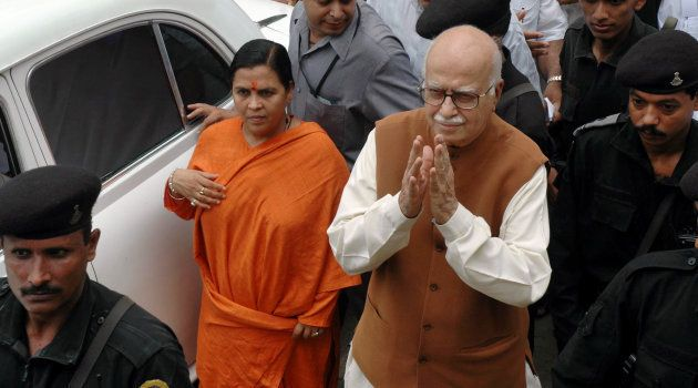 LK Advani and Uma Bharti at a court in Rae Bareilly after the court charged them over the destruction...
