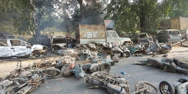 Smouldering vehicles seen following mob violence in