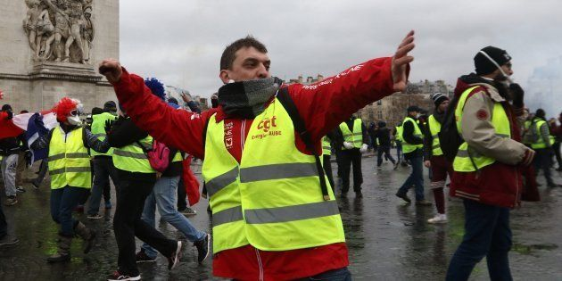Yellow vest protesters clash with riot police as part of demonstration against rising fuel