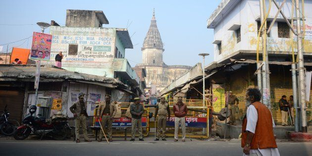 Security personnel keep watch on a street at the 26th anniversary of the demolition of the Babri