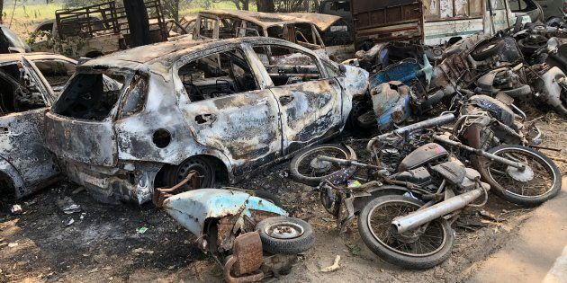 The vehicles torched by the angry mob near Chingravti police post in