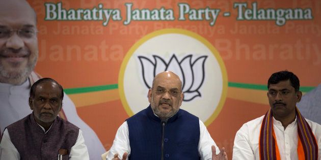 BJP President Amit Shah, center, with Telangana state party president K. Laxman, left, and National General-Secretary...