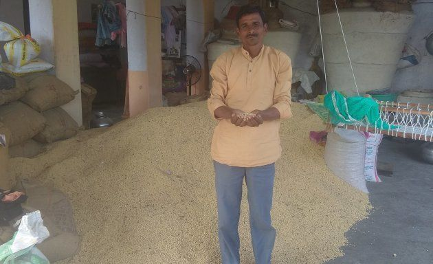 Gopal Dangi with a section of his Soyabean crop which survived, in a damaged form, after the late September...