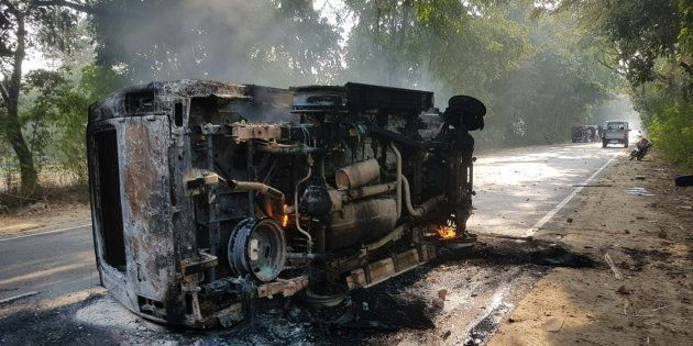An upturned vehicle seen after a mob violence at Chingravati village in