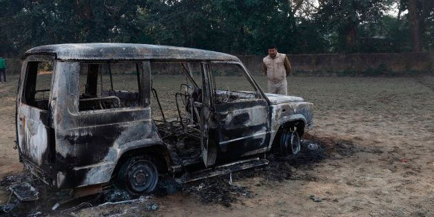 The vandalized remains of a car in which police Inspector Subodh Kumar Singh was fatally attacked, near...