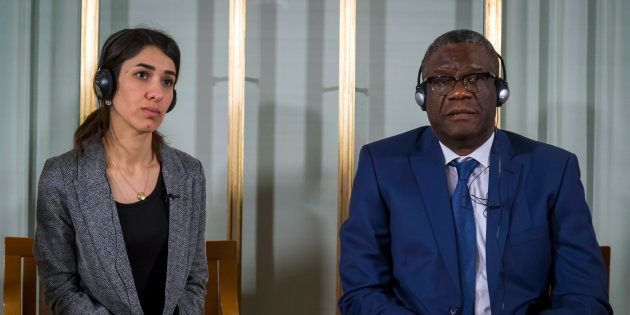 Nobel peace price laureates Nadia Murad, left, and Dr. Denis Mukwege look on during the press conference...