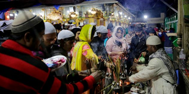 Devotees at the Nizamuddin Dargah in a file