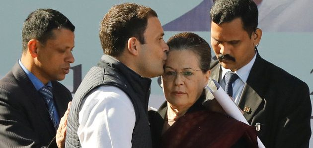 Rahul Gandhi, newly elected president of India's main opposition Congress party, kisses the forehead...