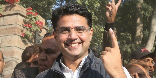 State Congress President and candidate from Tonk, Sachin Pilot, shows his inked finger after casting...