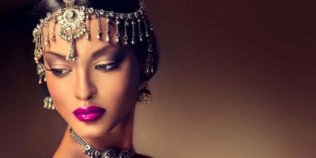 Beautiful Indian women portrait with jewelry . elegant Indian girl looking to the side ,bollywood
