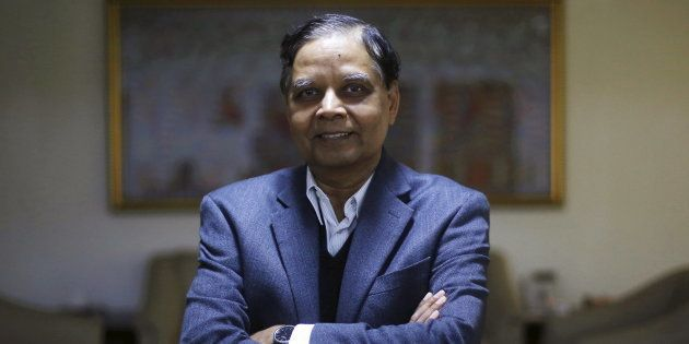 Arvind Panagariya, head of the government's main economic advisory body, poses for a picture after an...