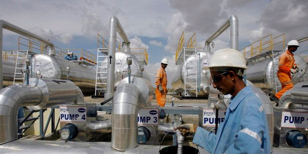Cairn India employees work at a storage