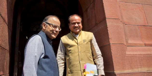 Indian Finance Minister Arun Jaitley, left, with Indian Minister for Chemicals and Fertilizers, Ananth...