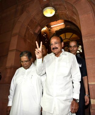 Parliametary Affairs Minister M Venkiah Naidu coming out after GST bill passed in both houses during...