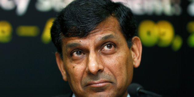 Reserve Bank of India (RBI) Governor Raghuram Rajan listens to questions during a news conference at...