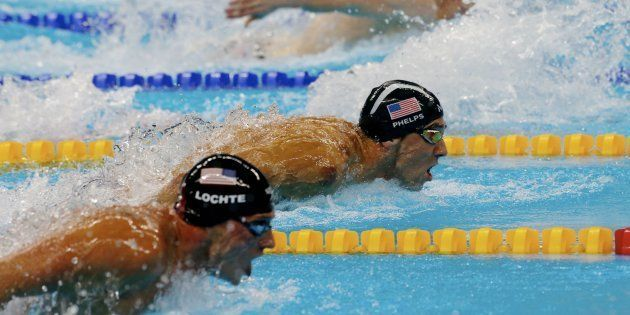 RIO DE JANEIRO, BRAZIL - AUGUST 10: Michael Phels of United States in action with Ryan Lochte of United...