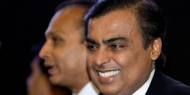 Mukesh Ambani (R), chairman of Reliance
