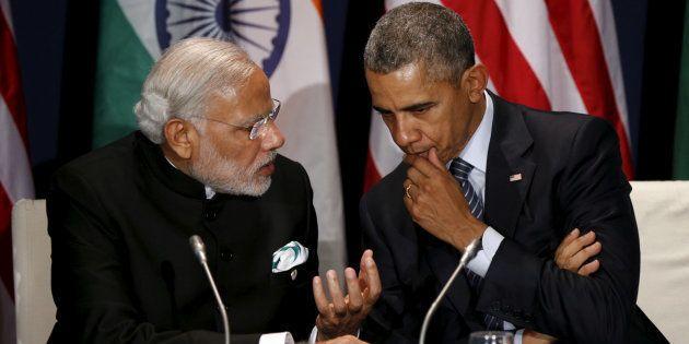 File photo of US President Barack Obama (R) with Indian Prime Minister Narendra