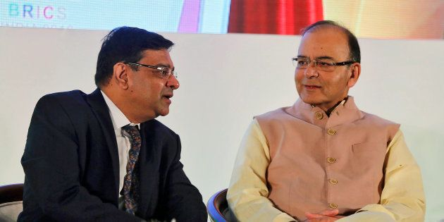 The Reserve Bank of India (RBI) Governor Urjit Patel speaks with India's Finance Minister Arun Jaitley...