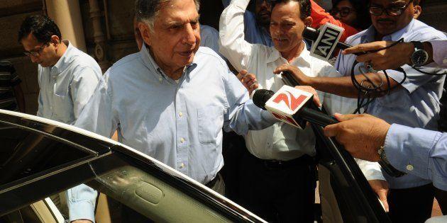 India's Tata Group's interim Chairman Ratan Tata (2nd L) leaves Bombay