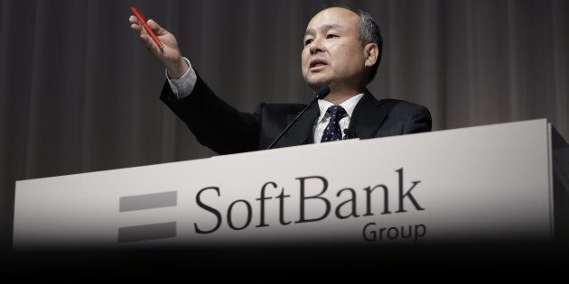 Billionaire Masayoshi Son, chairman and chief executive officer of SoftBank Group Corp., gestures as...