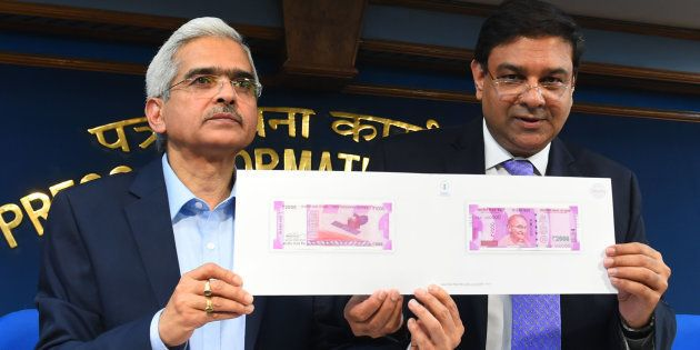 Indian Economic Affairs Secretary Shashi Kant Das (L) and Governor of the Reserve Bank of India Urjit...