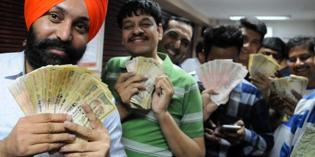 People in queue at an ATM for deposit their 500 and 1000 rupee notes at Phase 7 on November 8, 2016 in...