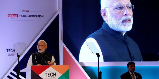 Indian Prime Minister Narendra Modi addresses a gathering during the India-UK Tech Summit in New Delhi,...