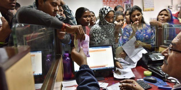 A banker exchanging defunct currency notes at PNB branch, on November 16, 2016 in New