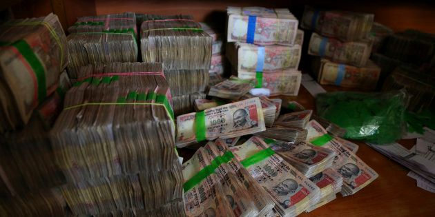 Indian currency notes of 1,000 denomination are seen after they were deposited by people at a bank in...