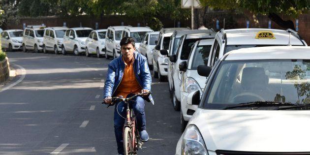 NEW DELHI, INDIA - FEBRUARY 14: Ola, Uber taxis seen at Jantar Mantar on February 14, 2017 in New Delhi,...
