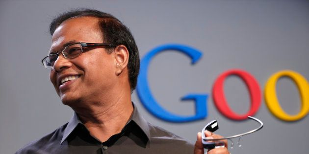 Amit Singhal, formerly senior vice president of search at Google, holds a Google Glass as he speaks at...