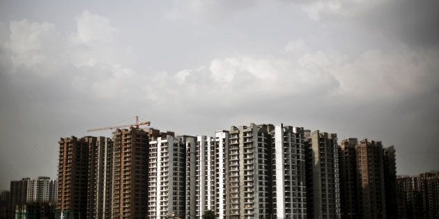 A view shows a residential complex that is under construction in Noida on the outskirts of New Delhi,...