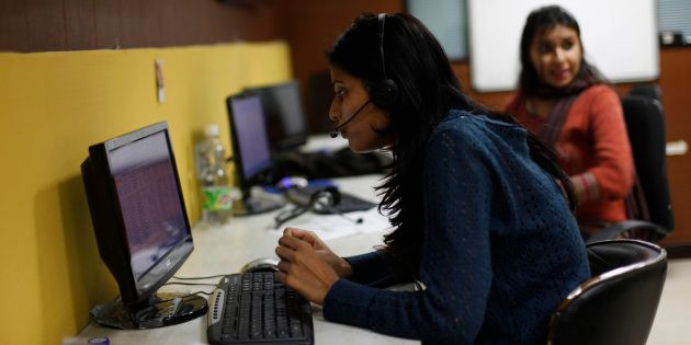 Sheetal, 23, who works at a night call centre, poses for a photograph in her office in New