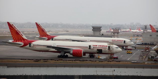 Air India aircrafts are seen parked on the tarmac of the international airport in