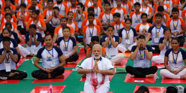 Indian Prime Minister Narendra Modi performs yoga on International Yoga Day in Lucknow, India June 21,...