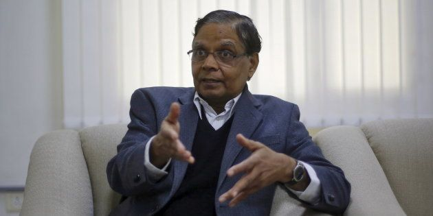 Arvind Panagariya, head of the government's main economic advisory body, gestures during an interview...