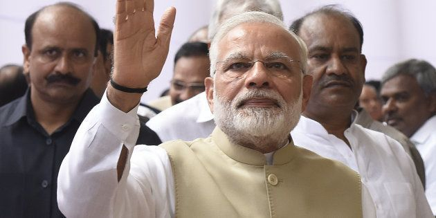 Prime Minister of India Narendra Modi waves his hand after casting his vote during the presidential election,...
