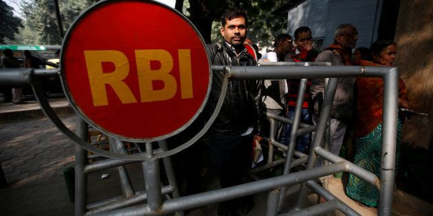 People queue outside the Reserve Bank of India (RBI) to exchange their old high denomination bank notes...