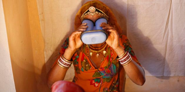 A villager goes through the process of eye scanning for Unique Identification (UID) database system at...