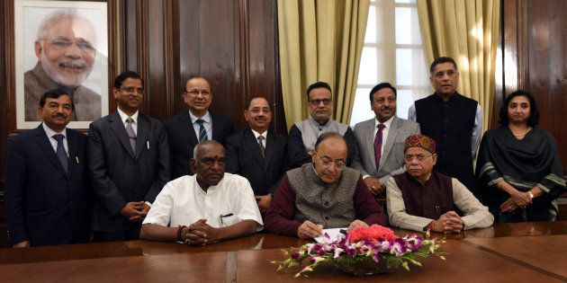 Union Finance Minister Arun Jaitley along with Shiv Pratap Shukla (R), P Radhakrishnan (L) along with...