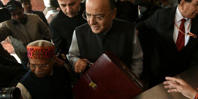 Indian Finance Minister Arun Jaitley (C) arrives at Parliament House to present the Union Budget in New...