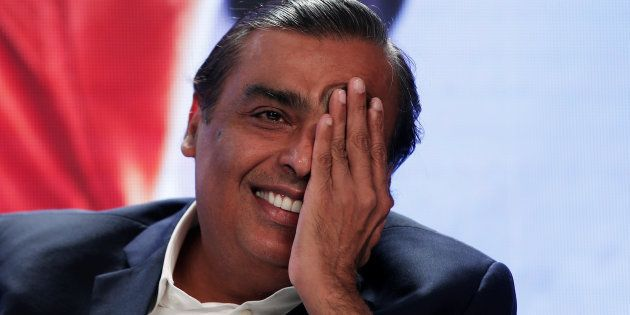 Mukesh Ambani, Chairman and Managing Director of Reliance Industries, gestures as he answers a question...