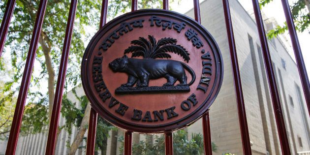 The Reserve Bank of India (RBI) logo is displayed on a gate at the central bank's headquarters in New
