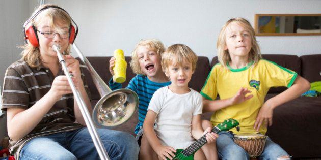SANKT AUGUSTIN, GERMANY - AUGUST 05: Four brothers at age of three, six, eight and twelve making music...
