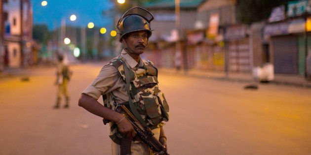 SRINAGAR, KASHMIR, INDIA - JULY 10: Security forces stand guard in the city centre, during curfew after...