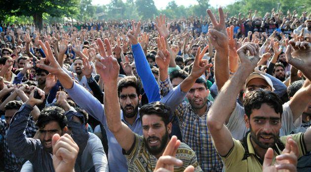 SRINAGAR, INDIA -JULY 9: Kashmiri people gather during a funeral procession of Hizbul Mujahideen commander...